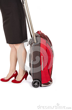 Woman Wearing Black Pencil Skirt and Pumps Pulling a Small Travel Luggage #1