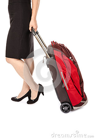 Woman Wearing Black Pencil Skirt and Pumps Pulling a Small Travel Luggage #2