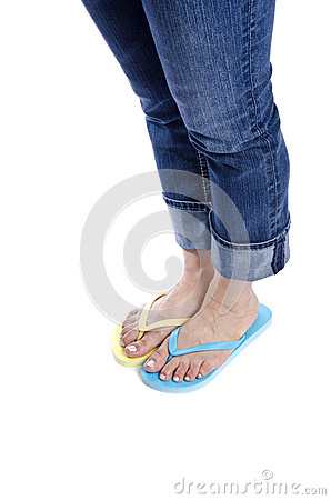 Woman Wearing Blue Jeans and Flip Flops #1