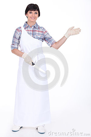 Woman wearing a butcher s uniform