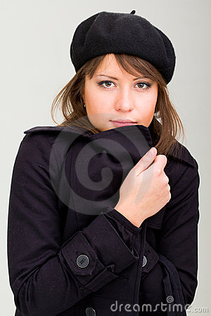 Woman wearing in a coat and beret