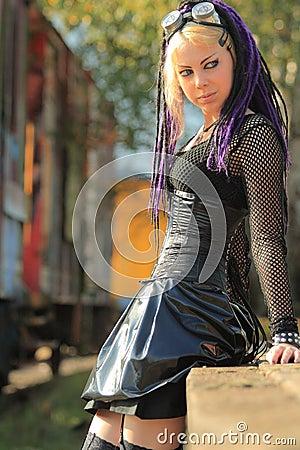 Woman wearing corset on trainplatform