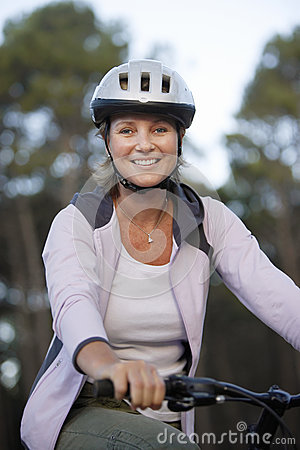 Free Woman Wearing Cycling Helmet And Pink Hooded Sports Top, Sitting On Bicycle, Smiling, Portrait Stock Photography - 41712052