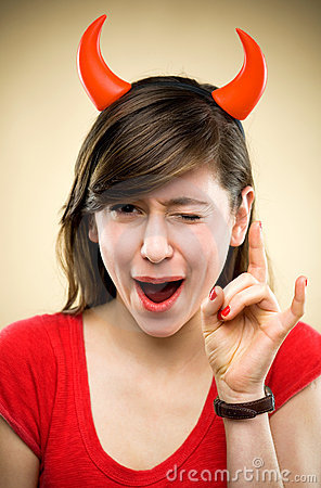 Woman wearing devil horns