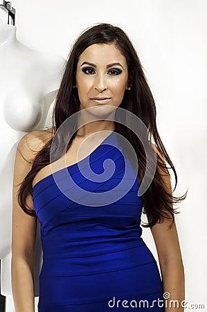 Woman wearing dress beside mannequin