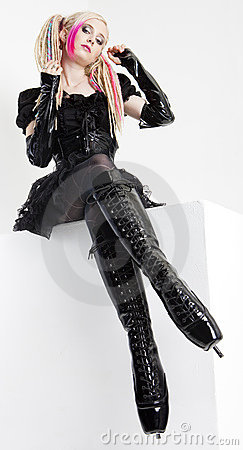 Woman wearing extravagant clothes and boots