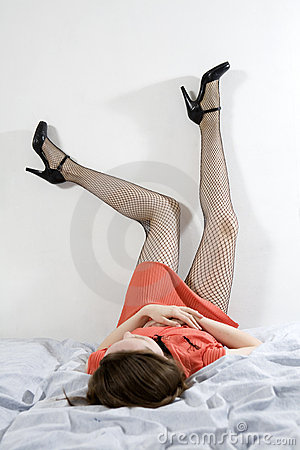 Woman wearing fishnet stocking upside-down