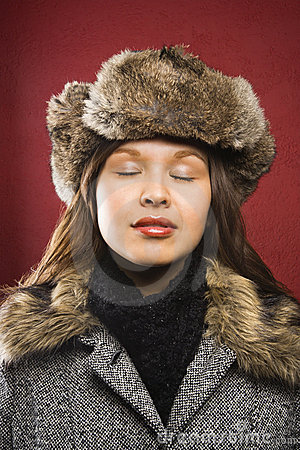 Woman wearing fur hat.