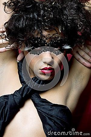 Woman wearing a gem mask