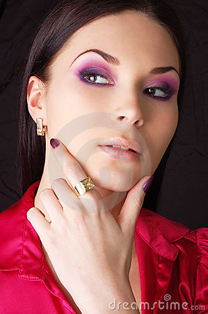 Woman wearing golden earring and ring