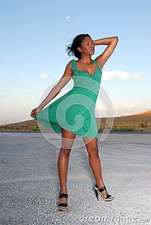Woman wearing green dress.