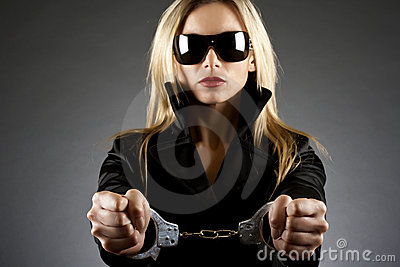 Woman wearing handcuffs
