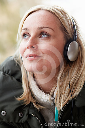 Woman Wearing Headphones And Listening To Music