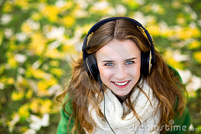 Woman wearing headphones outdoors