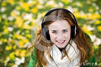 Woman wearing headphones outdoors