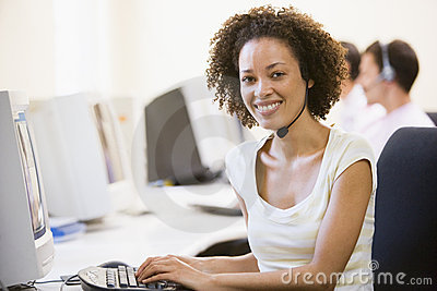 Woman wearing headset in computer room