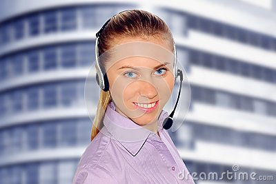 Woman wearing headset in office;could be reception