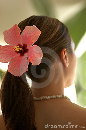Woman Wearing Hibiscus Flower