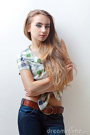 Woman wearing jeans and plaid shirt