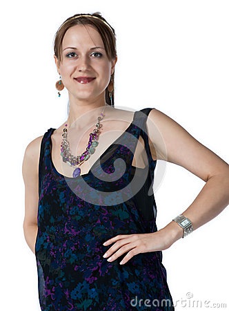 Woman wearing jewelery and a slight smile