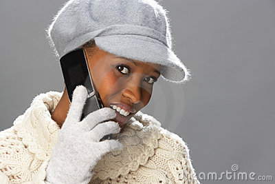 Woman Wearing Knitwear In Studio Using Mobile