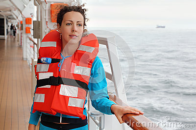 Woman wearing in life jacket looks into distance