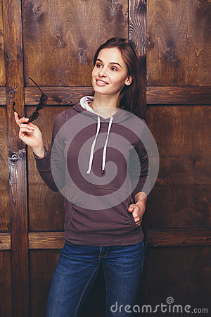 Free Woman Wearing Magenta Sweatshirt In Front Of Wooden Wall Royalty Free Stock Images - 85376089