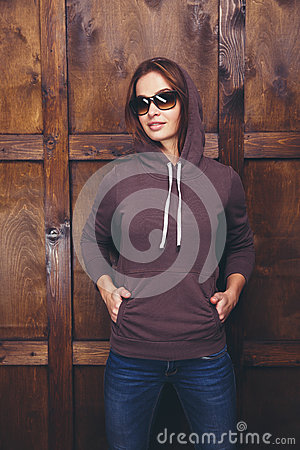 Free Woman Wearing Magenta Sweatshirt In Front Of Wooden Wall Stock Images - 85376284
