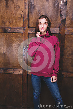 Free Woman Wearing Magenta Sweatshirt In Front Of Wooden Wall Stock Photography - 85376832