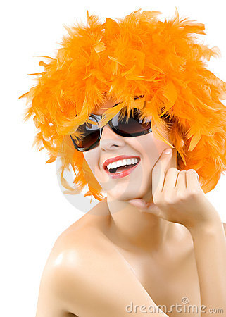 Woman wearing an orange feather wig and sunglasses
