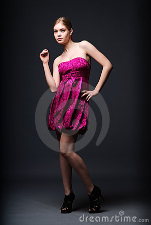 Woman wearing pink dress and high heels