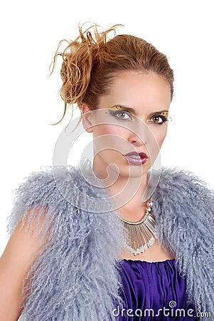 Woman wearing a purple fur vest