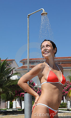 woman wearing red bathing suit takes shower