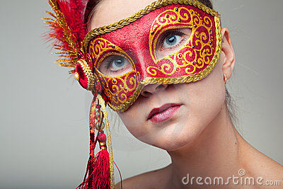 Woman wearing red carnival mask