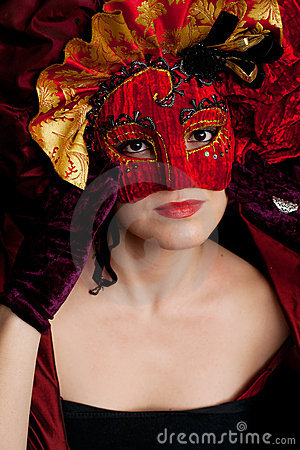 Woman wearing a  red carnival mask