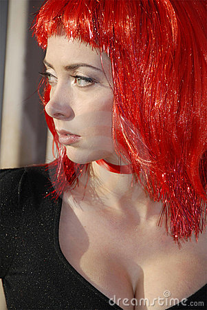Woman wearing red glitter wig