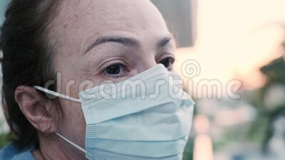 Woman wearing respiratory protective mask stock footage