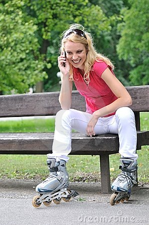 Woman wearing rollerblades calling