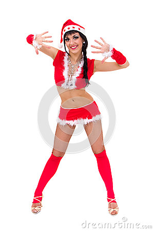 Woman wearing santa claus clothes posing