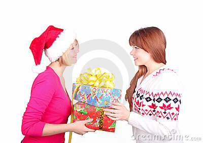 Woman wearing santa hat giving christmas present t