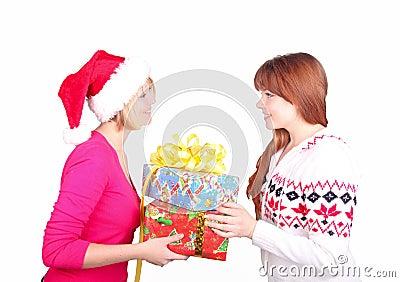 Woman wearing santa hat giving christmas present t