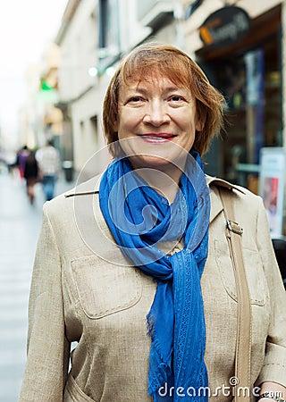 Woman wearing scarf in city street