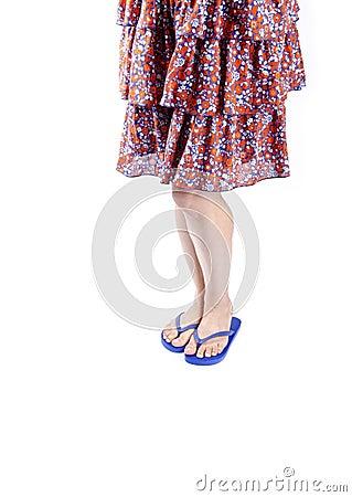 Woman Wearing Skirt and Blue Flip Flops