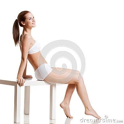 Woman wearing  underwear over white