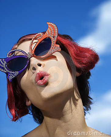 Woman wearing unique glasses.