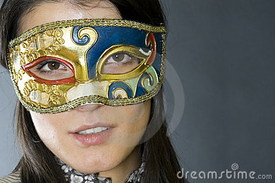Woman wearing venetian mask