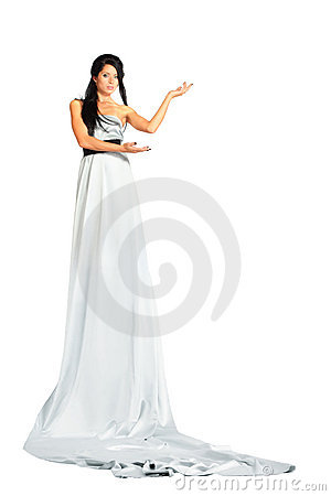 Woman wearing very long silver dress stands