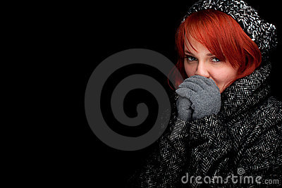 Woman wearing a warm winter hat and coat