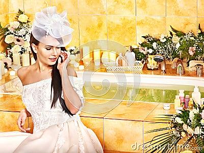 Woman wearing wedding dress.
