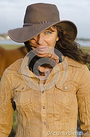 Woman wearing western hat